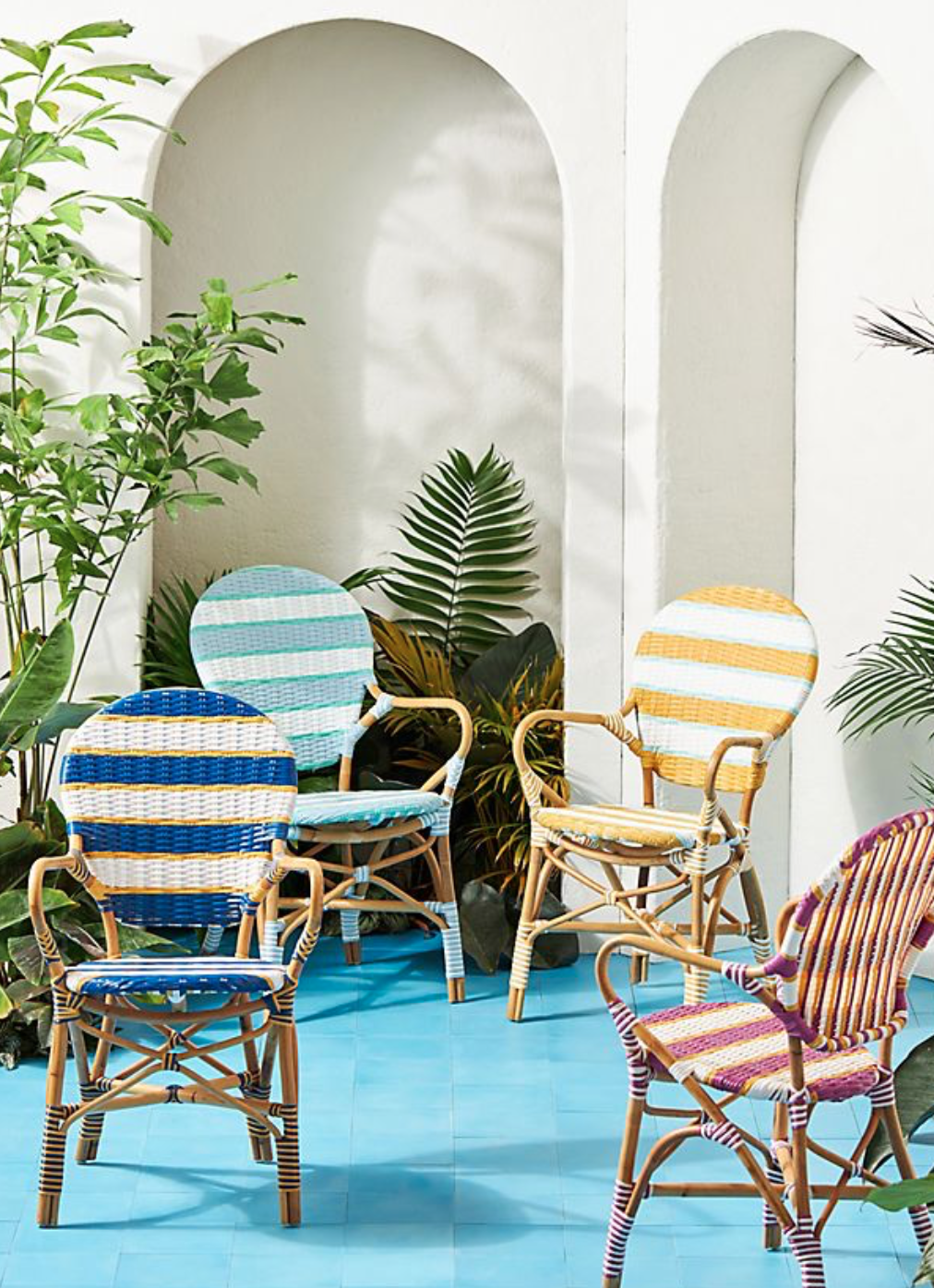Brightly coloured plastic woven fresh style outdoor bistro chairs from Anthropologie