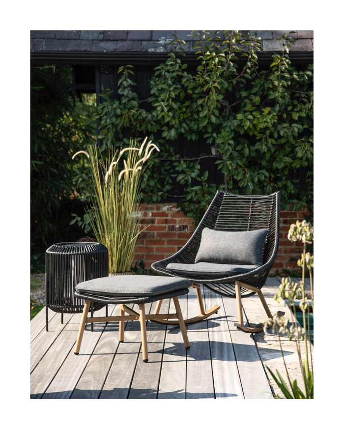 Scandi inspired black woven and wood outdoor rocking chair and foot stool with charcoal grey cushions