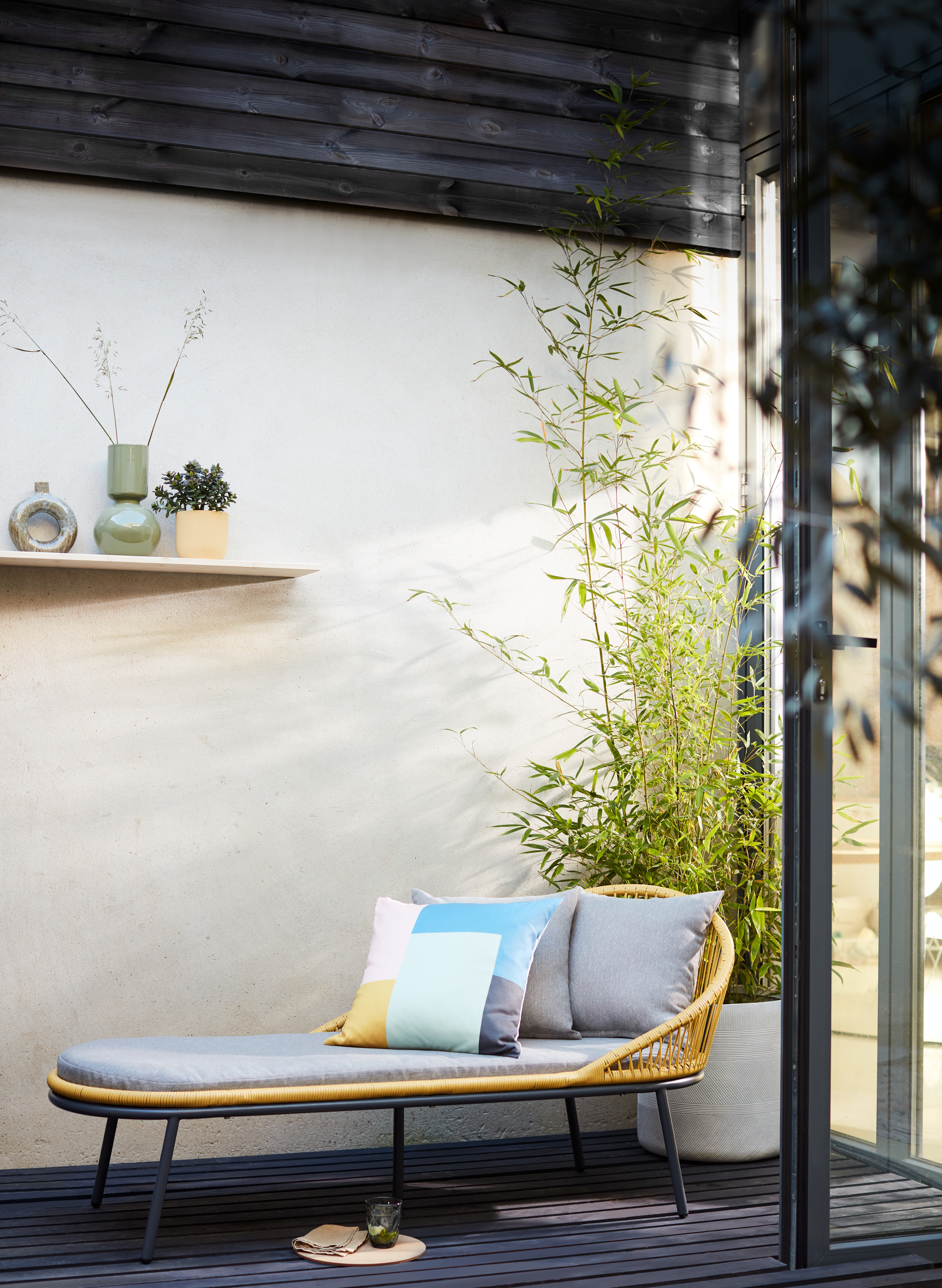 Woven and metal indoor outdoor chaise longe / daybed. With retro style and a nod to Scandi design, perfect for gardens and balconies