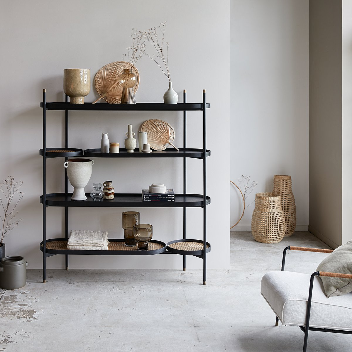 Modern black and cane bookcase.
